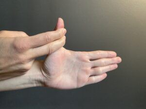 thumb extension stretch - physical therapy - physiotherapy - exercises - stretching - rehabilitation